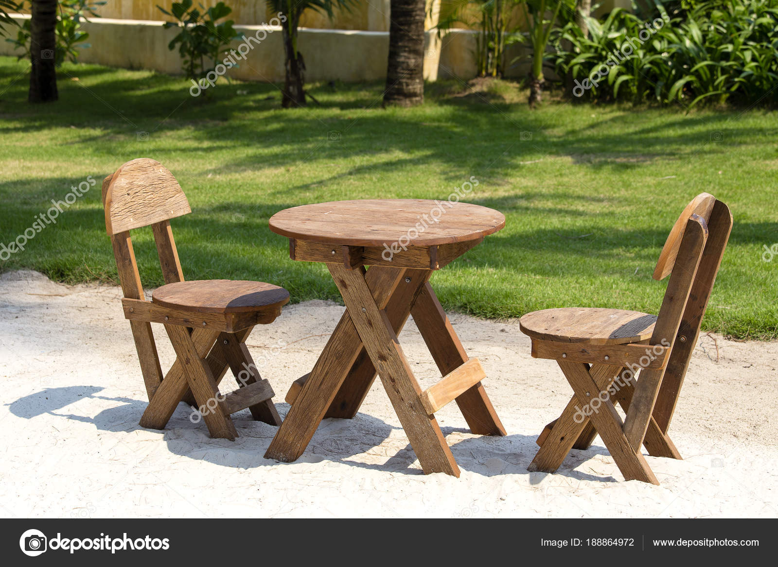 Table And Wooden Chairs In Tropical Garden Next To The Sea On The Sand  Beach,