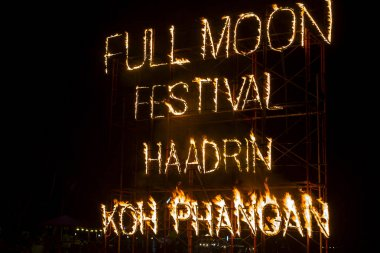 Full Moon Party fire sign on Haad Rin beach in island Koh Phangan, Thailand. Event now attracts anywhere about 30,000 party-goers on a normal month stock vector
