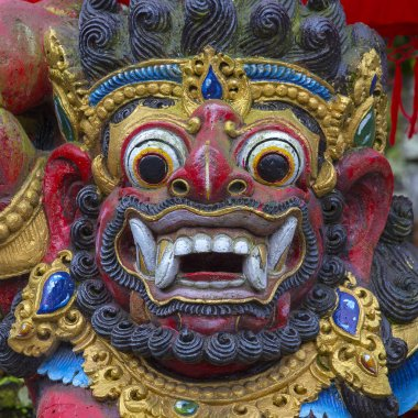 Traditional Balinese statue of Barong on a street temple in Bali, Indonesia
