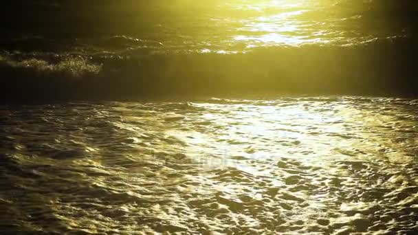 Slow motion sunlight on the stormy sea and wave