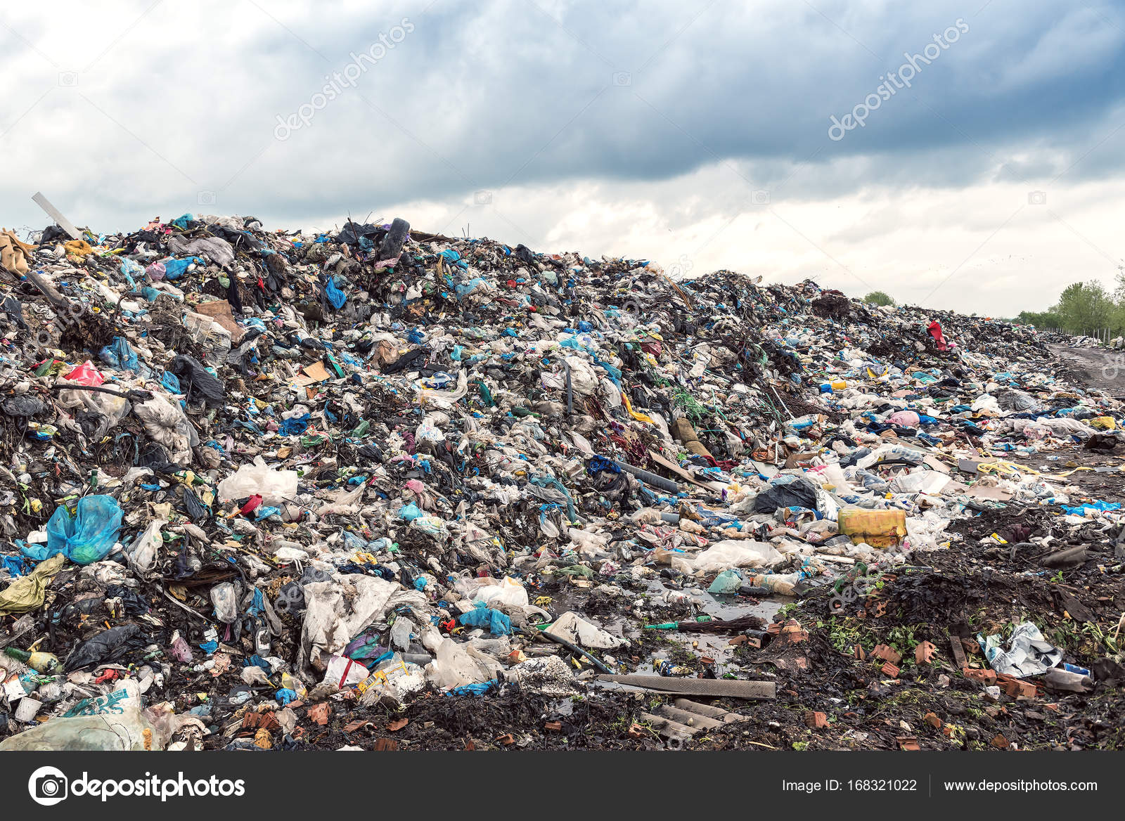 Garbage Collectors Separating Waste Atop A Mound Of At Landfill In Delhi Last Month