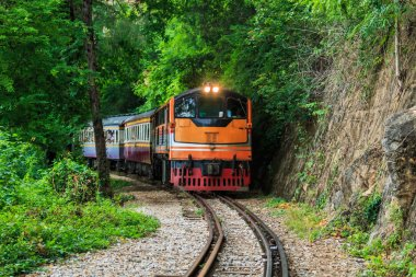 Train running past tunnel kanjanaburi