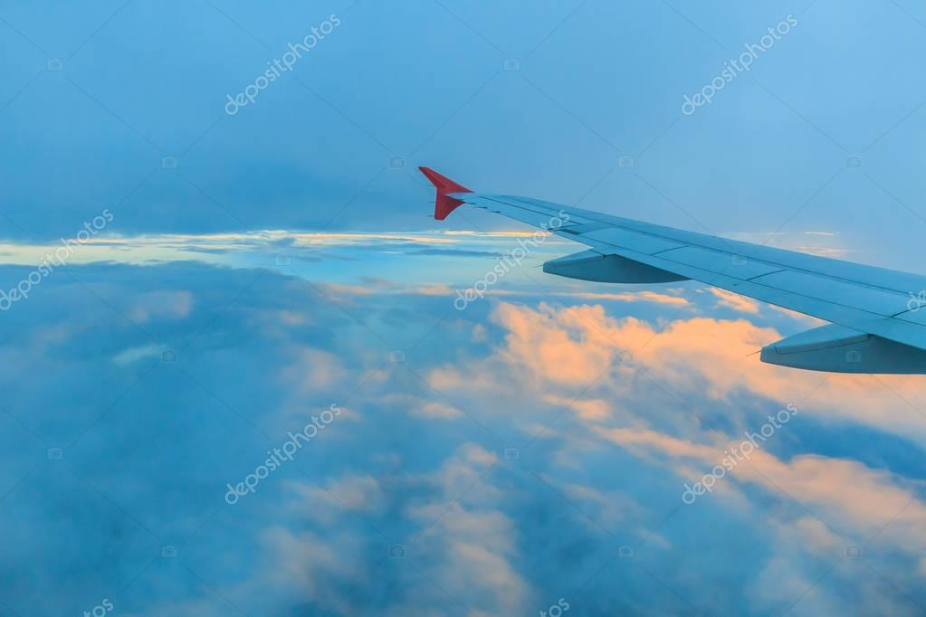 Wing and clouds at sunset