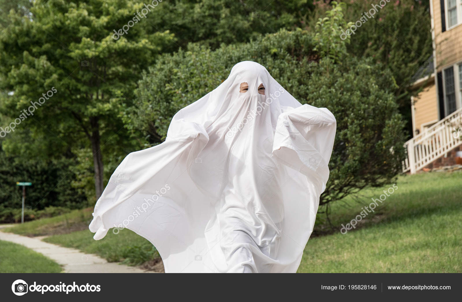 A child in a ghost costume made out of a bedsheet running down the sidewalk. u2014 Photo by LineWeight & Child Ghost Costume Made Out Bedsheet Running Sidewalk u2014 Stock Photo ...