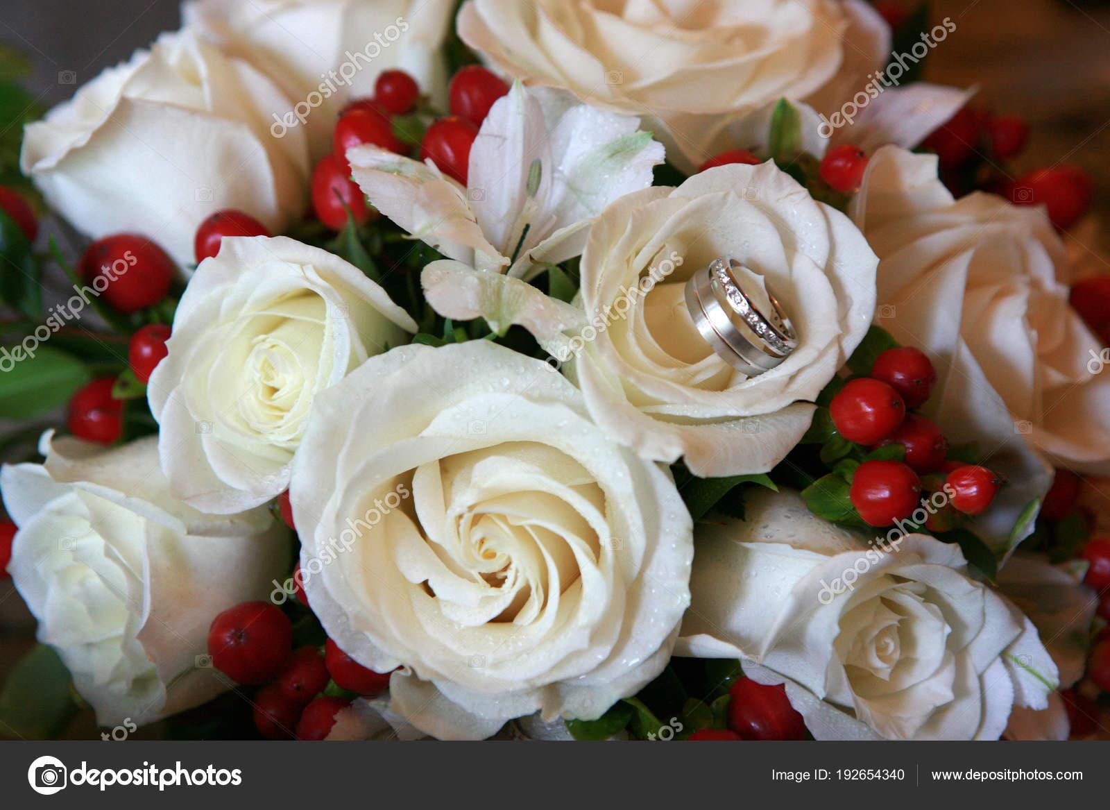 Wedding bouquet with wedding rings stock photo beckerphotos beautiful white roses wedding bouquet with the wedding rings in one flower photo by beckerphotos izmirmasajfo