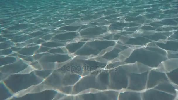Moving Underwater Camera Over Sandy Seafloor With Abstract Sunlight Reflections And Textures Greece Stock Footage