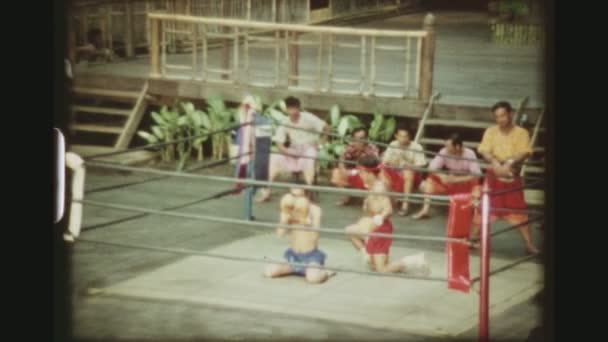 THAILAND, BANGKOK SAMPRAN RIVERSIDE, MAY 1978. Two Male Muay Thai Kickboxers Praying And Concentrating With The Ram Muay Ritual In The Boxing Ring Before The Match, At The Cultural Village Show.