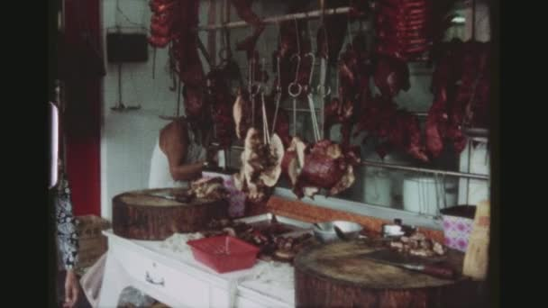 HONGKONG, AP LEI CHAU, MAY 1978. Three Shot Sequence At Aberdeen Fishing Village. A Picturesque Harbour With A Butchery And Busy Meat And Vegetable Street Markets With Different Shops.
