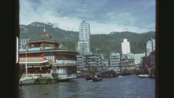 HONGKONG, AP LEI CHAU, MAY 1978. Three Shot Sequence Out Of A Moving Boat Through The Aberdeen Harbor, With Junks And Tourists Cruising In Sampan.