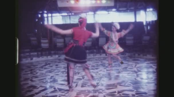 TAIWAN, HUALIEN CITY, APRIL 1977. Two Women From The Kavalan Tribe Dancing Together In Traditional Colorful Costumes At The Ami Village Cultural Show.