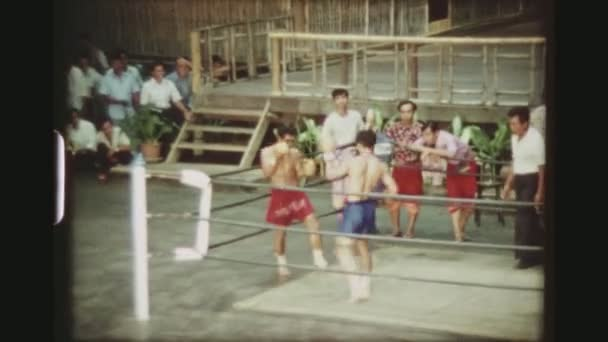 THAILAND, BANGKOK SAMPRAN RIVERSIDE, MAY 1978. Two Male Muay Thai Kickboxers Fighting Each Other In A Hard Boxing Match At The Cultural Village Show, At The Sampran Riverside.