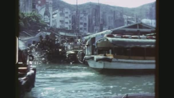 HONGKONG, AP LEI CHAU, MAY 1978. Four Shot Sequence Out Of A Cruising Boat In The Aberdeen Fishing Village. Everyday Life With A Group Of Native Boys On A Sampan Rowing By.