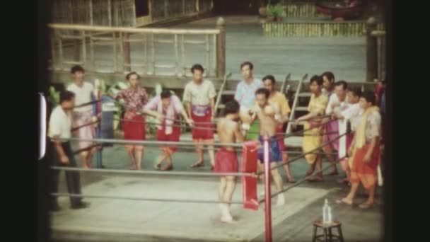THAILAND, BANGKOK SAMPRAN RIVERSIDE, MAY 1978. Three Shot Sequence Of Two Muay Thai Kickboxers Beating And Hitting Each Other Until One Hits The Ground, At The Cultural Village Show.
