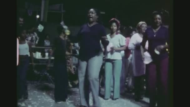BRAZIL, RIO DE JANEIRO, MARCH 1976. Women And Children Singing And Dancing Samba Together In A Public Open Air Club.