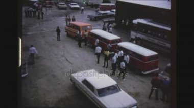 JAMAICA, MONTEGO BAY, MAY 1971. Two Shot Sequence Of Tourist Buses And Tour Guides Awaiting Cruise Ship Passengers To Disembark At The Harbour.