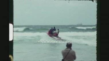 AUSTRALIA, PERTH, MARCH 1971. Competition Judges In A Small Motor Boat Driving Over The Breaking Waves Into The Open Sea During The Australian Surf Life Saving Championships.