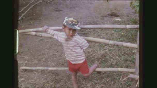THAILAND, MAE SALONG, DECEMBER 1983. Portrait Of A Small Young Boy At A Karen Hill Tribe Village, Wearing A Tiger Cap.