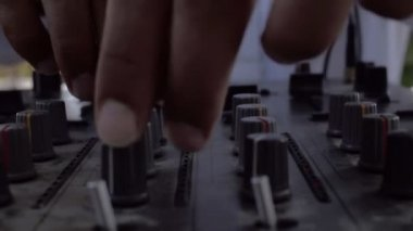 Moving Slow Motion Close Up Of Male Dj Hands With Golden RIngs Mixing A Track  On An Audio Console During A Summer Wedding Party