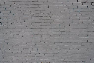 Abstract texture painted old plaster light grey and aged paint white brick wall background.