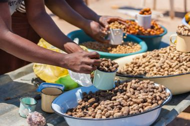african street vendors selling traditional food