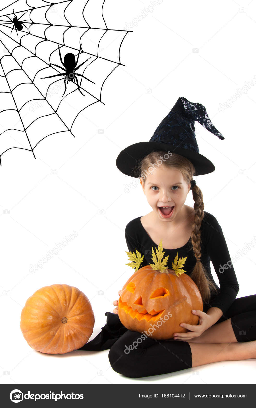 Halloween Little Girl With Open Mouth Holding A Pumpkin Stock
