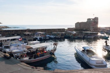 Byblos, Lebanon - May 12, 2017: Parked boats at jetty for rentals at Byblos bay.