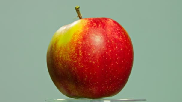 Red apple rotating on isolated background