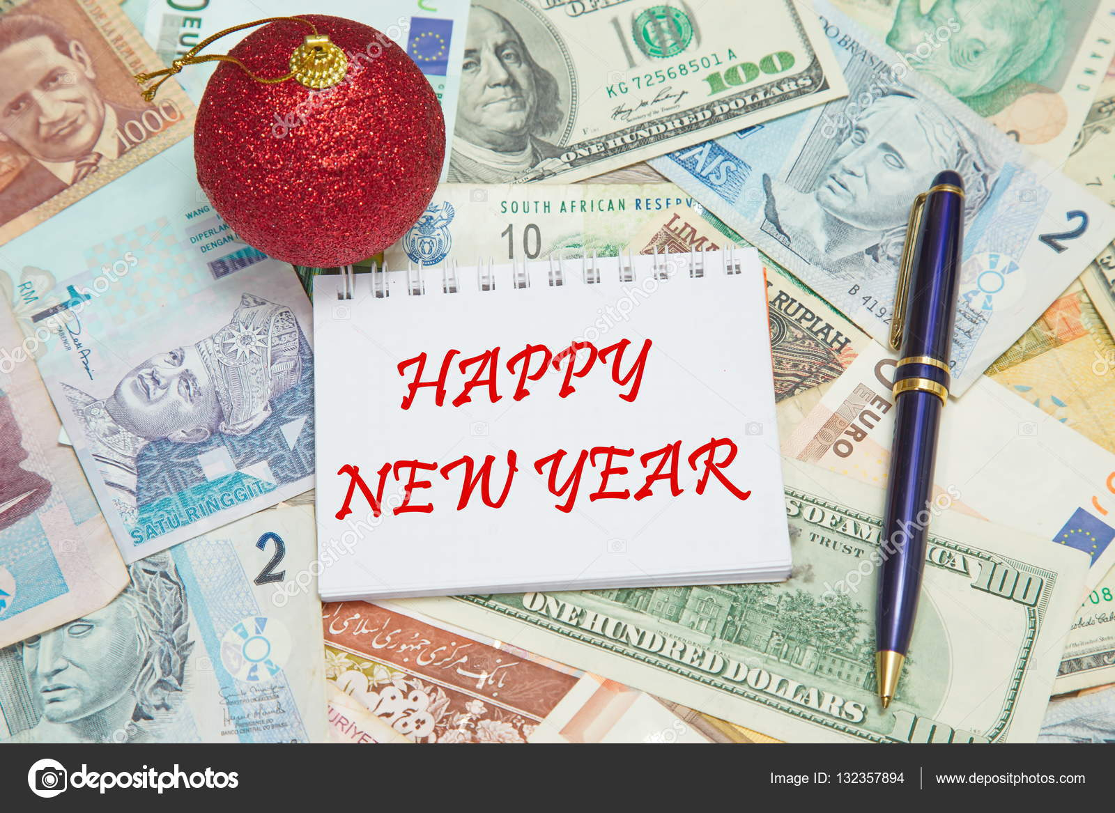 notebook page with text happy new year background from different world currencies stock photo