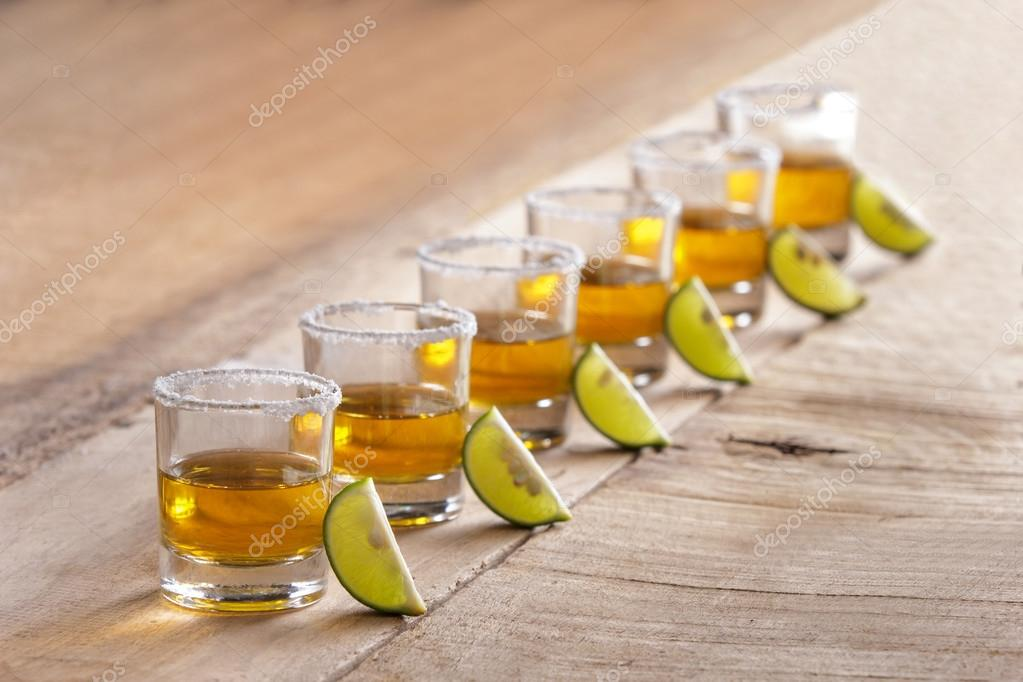 six tequila shots in a row with lime slice and salt — Stock Photo ...