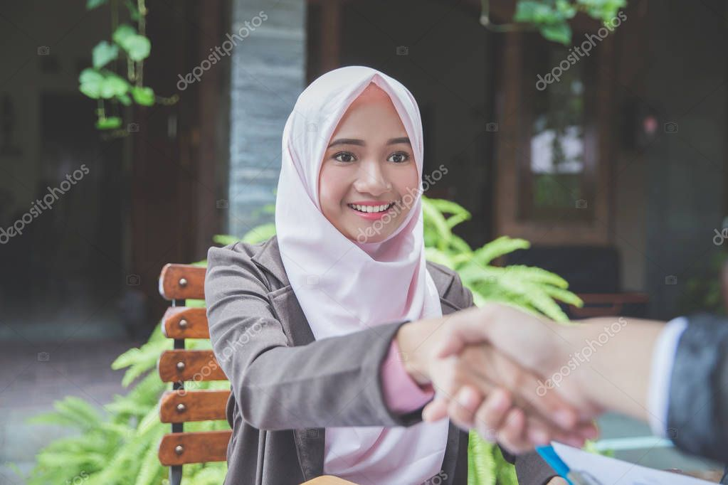 business woman shake her hands