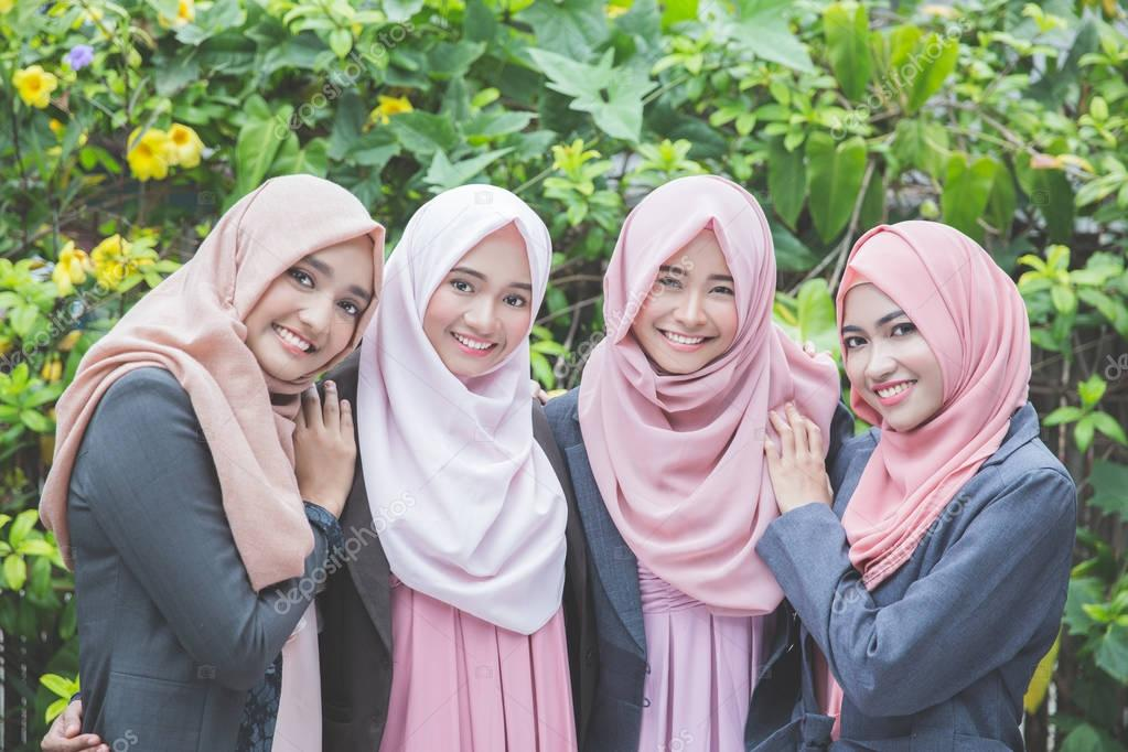 team of asian muslim business woman