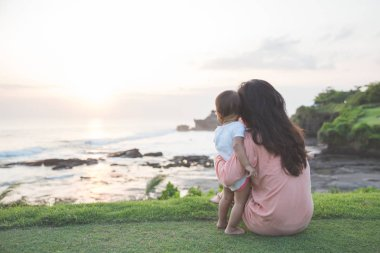 Portrait of mother and baby in sunset
