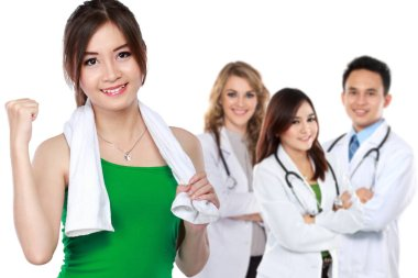 Woman with towel and smiling doctors
