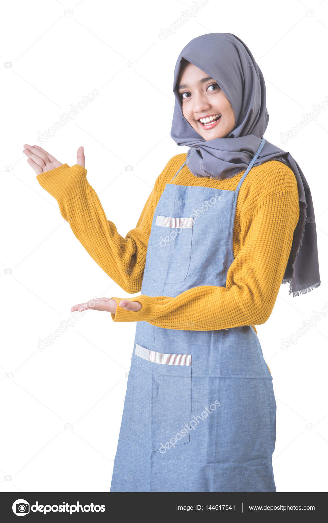 Attractive Female Cafe Worker With Hijab Presenting To Copyspace Stock Photo C Odua 144617541