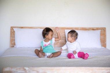 little babies having fun in bed
