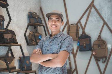 shopkeeper at his bag store