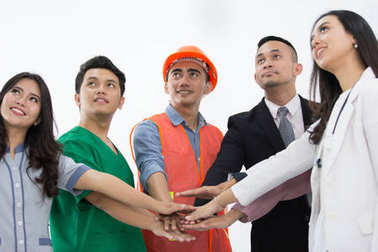 Portrait of various professions shake hand