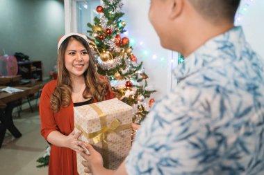 couple giving christmas present