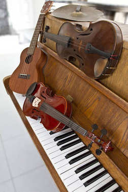 Classical violins on piano keys, guitar and cymbal. Classical musical instruments for music background concept