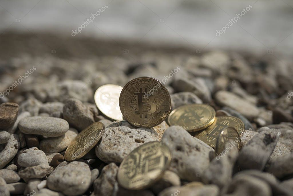 bitcoin Cryptocurrency. e-currency. sea. summer beach. sea stones