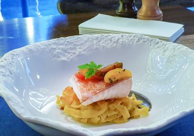sea bass, spaghetti, and seasoning from olives