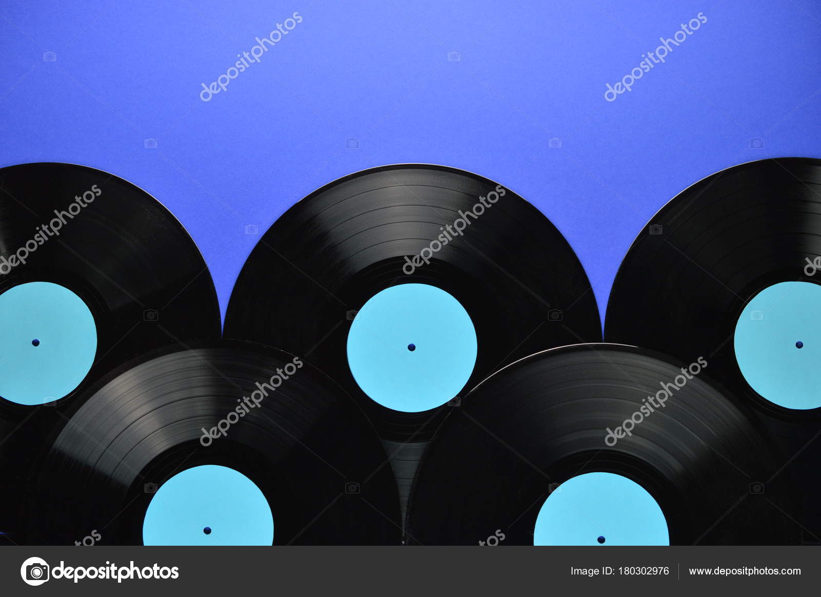 border old black vinyl records blank cyan labels blue background