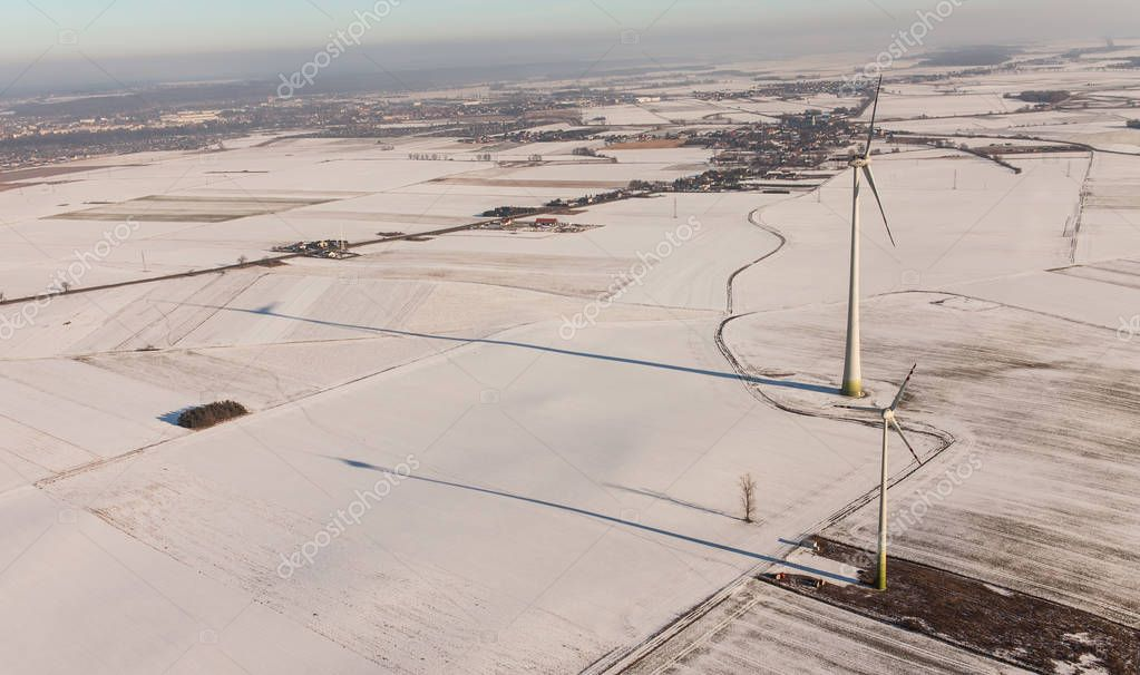 wind turbines on winter field in Poland