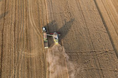 aerial view of combine on harvest fields