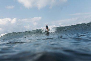 Sportsman surfing wave on board in ocean stock vector