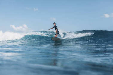 Sportsman surfing wave on surf board in ocean stock vector