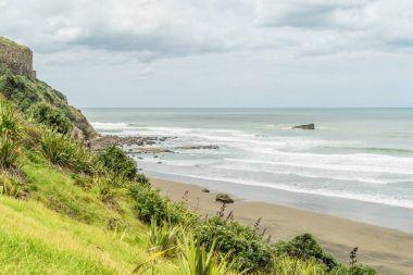 Dramatic shot of wavy ocean under cloudy sky, Muriwai beach, New Zealand stock vector