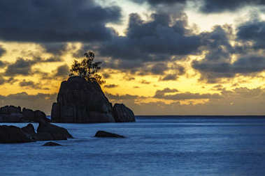 Mystic sunset over rock with single tree. seychelles 4