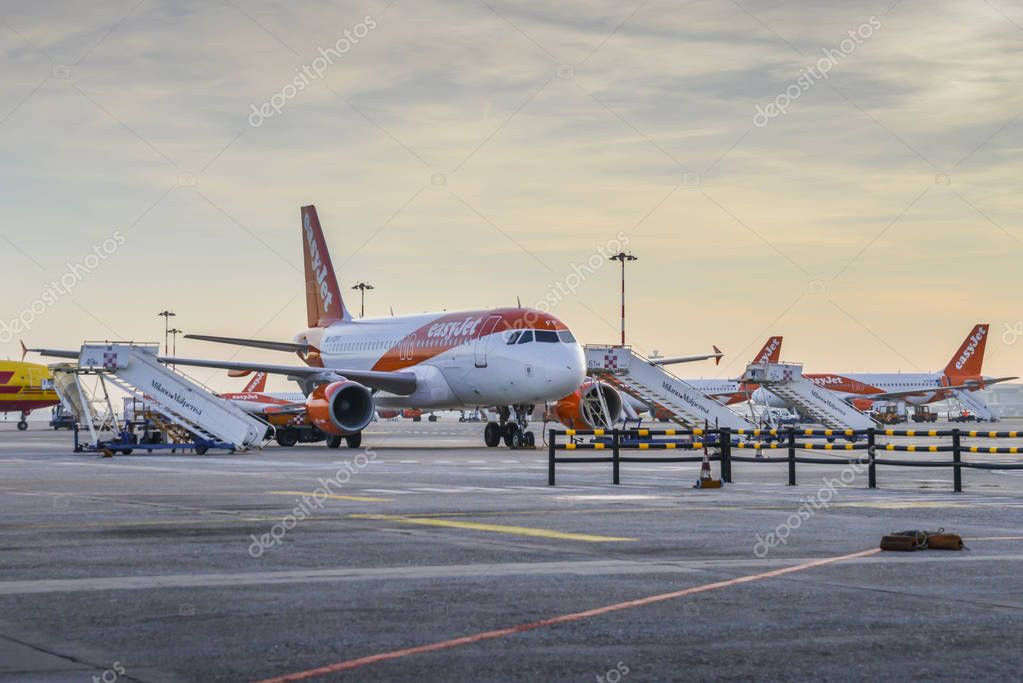 Row of Easyjet Airbus A320 airplanes on the tarmac at Milan Malpensa airport, servicing short-haul flights in Europe