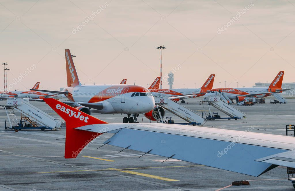 Easyjet Airbus A320 airplanes at Milan Malpensa airport tarmac. Airliner services short-haul flights in Europe